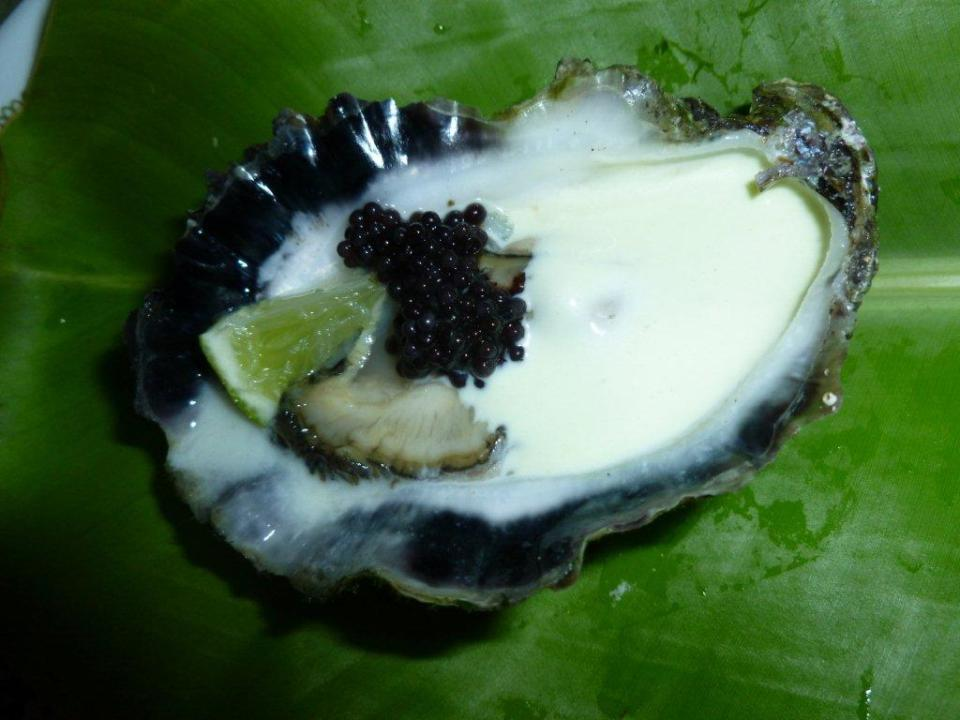 Natural Oysters with Wasabi Dressing and Caviar.